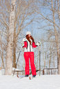 Woman in a sporting suit on skis in-field Stock Photos