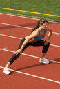 Woman in Sports Bra Doing Leg Lunge Stock Photos