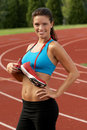 Woman in Sports Bra with Running Shoes Tied Around Her Neck Stock Images