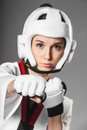 Woman in sports clothing closeup on the gray background Stock Photos