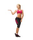 Woman in sportswear with empty hand beautiful athletic Stock Photography
