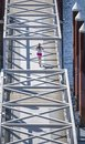Woman in sportswear runs on a floating dock on the river Royalty Free Stock Photo