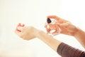Woman spraying perfume on her wrist Royalty Free Stock Photo