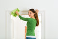 Woman at the spring cleaning young home she has a day and using a duster or dust cloth Royalty Free Stock Photography