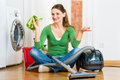 Woman at the spring cleaning young home she has a day and using a vacuum cleaner products and a bucket Stock Image
