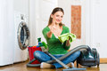 Woman at the spring cleaning young home she has a day and using a vacuum cleaner products and a bucket Royalty Free Stock Photos