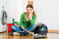 Woman at the spring cleaning young home she has a day and using a vacuum cleaner products and a bucket but she does not Royalty Free Stock Photo