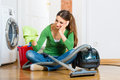 Woman at the spring cleaning young home she has a day and using a vacuum cleaner products and a bucket but she does not Royalty Free Stock Photos