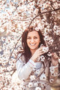 Woman in spring garden portrait of a beautiful the flowering branches Royalty Free Stock Image