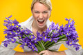 Woman with spring iris flower roar Royalty Free Stock Image