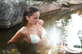 Woman in spring water beautiful natural enjoying peaceful relaxation Stock Image