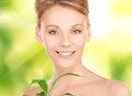 Woman with sprout picture of over green background Royalty Free Stock Photos