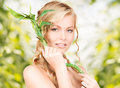 Woman with sprout picture of over green background Royalty Free Stock Image