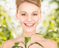 Woman with sprout picture of over green background Stock Photography