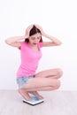 Woman  Squatting  on weight machine Royalty Free Stock Photo