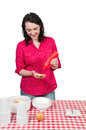 Woman squeezing catsup a ketchup condiment on a bun Royalty Free Stock Photo