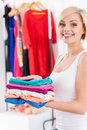 Woman with stack of clothes. Royalty Free Stock Photo