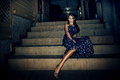 Woman on stairs elegant young in summer dress sit night shot Royalty Free Stock Photos