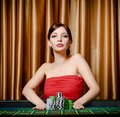 Woman stakes pile of chips playing roulette Stock Image