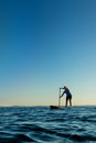 Woman on Stand Up Paddle Board Stock Photo