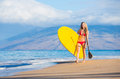 Woman with stand up paddle board attractive sup on the beach in hawaii Royalty Free Stock Photography