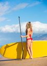 Woman with stand up paddle board attractive sup on the beach in hawaii Royalty Free Stock Images