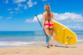 Woman with stand up paddle board attractive sup on the beach in hawaii Stock Image