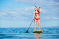 Woman on stand up paddle board attractive sup tropical blue ocean hawaii Stock Images