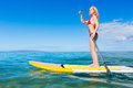 Woman on stand up paddle board attractive sup tropical blue ocean hawaii Royalty Free Stock Image
