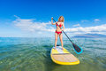 Woman on stand up paddle board attractive sup tropical blue ocean hawaii Stock Photos