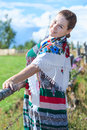 Woman standing behind fence in sundress and headscarf pretty sunny summer day Stock Photography