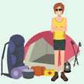 Woman standing with camping and hiking gear