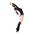 Woman standing en pointe arching backwards in a black leotard and leggings with her arms raised side view over white Royalty Free Stock Photo