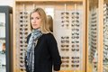 Woman standing in glasses store portrait of mid adult Royalty Free Stock Photography