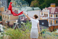 Woman standing on the hill and waving a red scarf Royalty Free Stock Photo