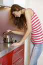 Woman standing at the kitchen Stock Photography