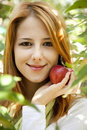 Woman standing near the apple tree. Royalty Free Stock Image