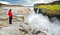 Woman standing near famous dettifoss waterfall in vatnajokull national park iceland panoramic view of northeast Stock Photography