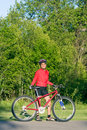 Woman Standing Next to Bicycle - Vertical Royalty Free Stock Photo