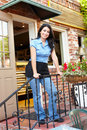 Woman standing outside bakery/cafe Stock Photography