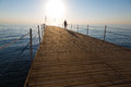 Woman standing on a pier Royalty Free Stock Photos