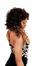 Woman standing in profile a young jamaican shorts and long black curly hair isolated for white background smiling Stock Photos