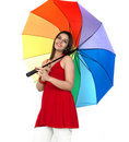 Woman standing with rainbow umbrella Stock Image