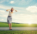 Woman standing on the road and screaming stressed Royalty Free Stock Photography
