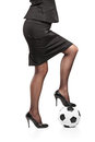Woman standing on a soccer ball Stock Photo