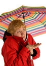 Woman standing under umbrella Royalty Free Stock Image