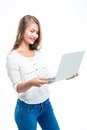Woman standing and using laptop Royalty Free Stock Photo