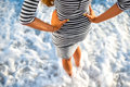 Woman standing in the white foam water Royalty Free Stock Photo