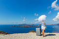 Woman  stands on a hill over the sea Royalty Free Stock Photo