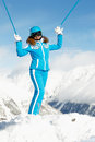 Woman stands rising up her hands with ski Royalty Free Stock Image